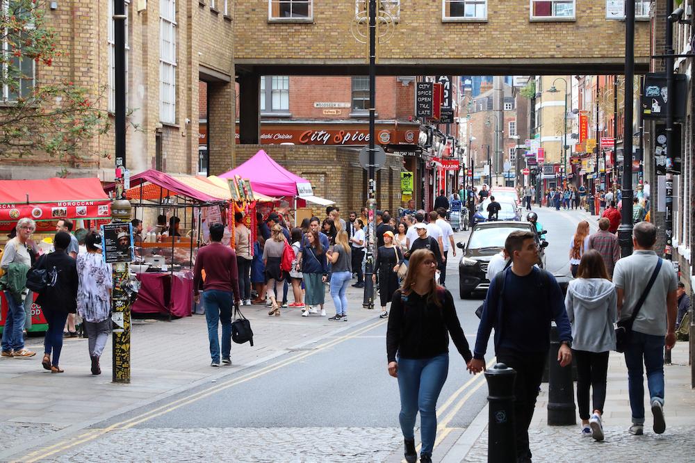 Brick Lane Market - People Walking Past Vendors